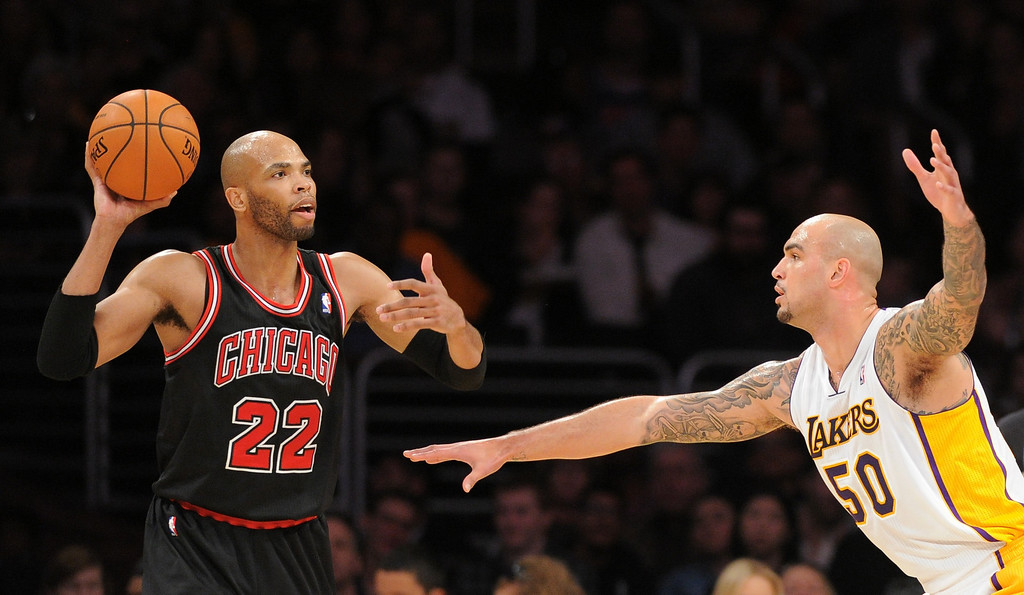 . Chicago Bulls\' Taj Gibson looks to pass over Lakers\' Robert Sacre in the NBA basketball game at Staples Center in Los Angeles, CA. on Sunday, February 9, 2014. (Photo by Sean Hiller/ Daily Breeze).