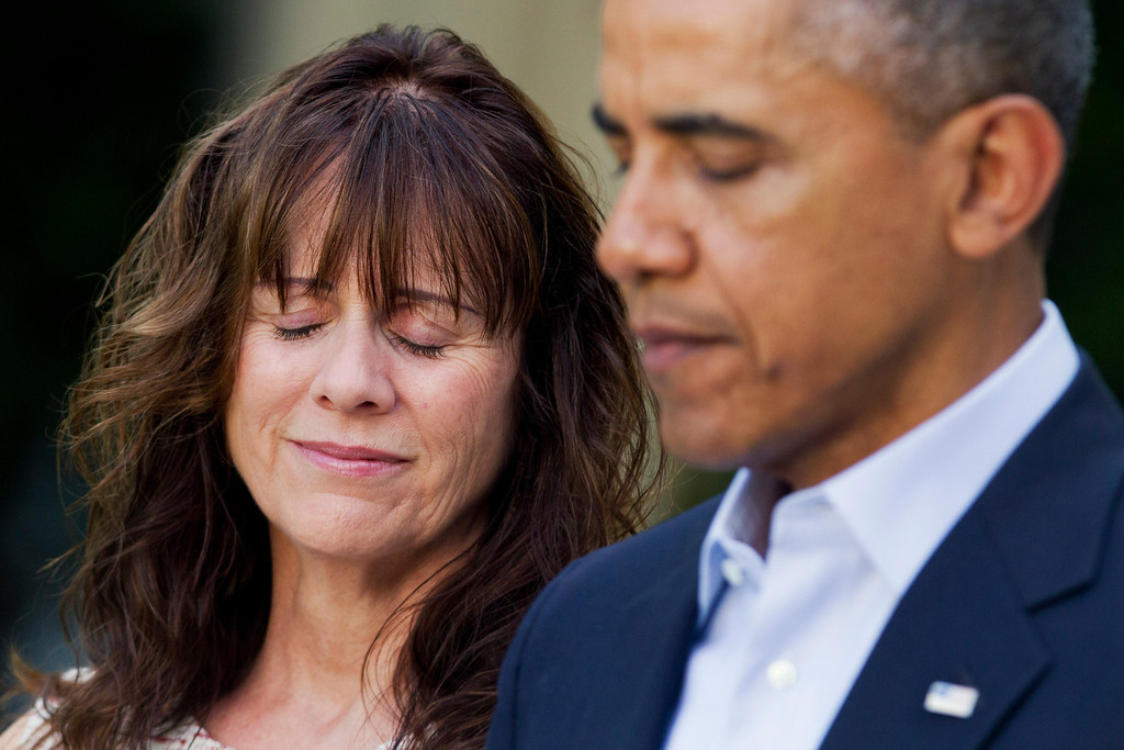 . Jani Bergdahl, mother of U.S. Army Sgt. Bowe Bergdahl, reacts as President Barack Obama speaks about the release of her son, during a news conference in the Rose Garden of the White House in Washington on Saturday, May 31, 2014. Bergdahl, 28, had been held prisoner by the Taliban since June 30, 2009. He was handed over to U.S. special forces by the Taliban in exchange for the release of five Afghan detainees held by the United States. (AP Photo/Jacquelyn Martin)