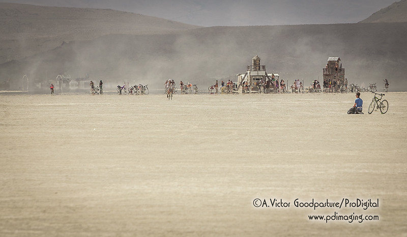 A lone burner meditates on a remote patch of the playa.
