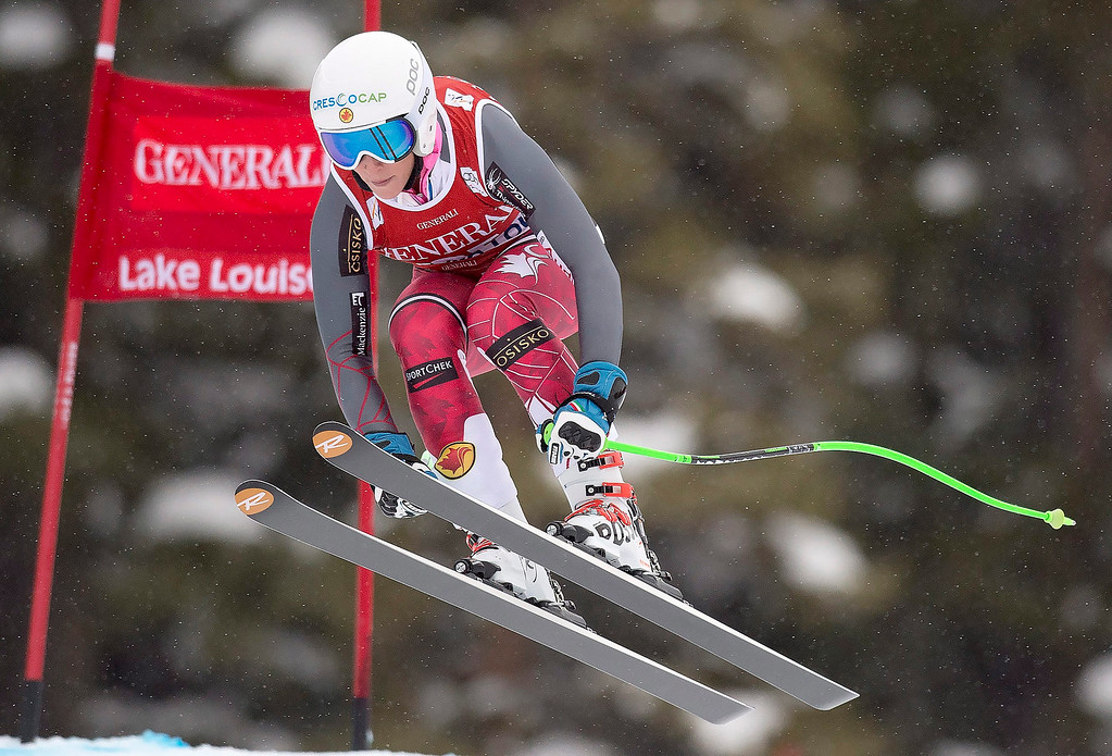 . Larisa Yurkiw of Canada soars down the course on her way to fourth place in the World Cup women\'s downhill ski race in Lake Louise, Alberta, Saturday, Dec. 6, 2014  (AP Photo/The Canadian Press, Frank Gunn)