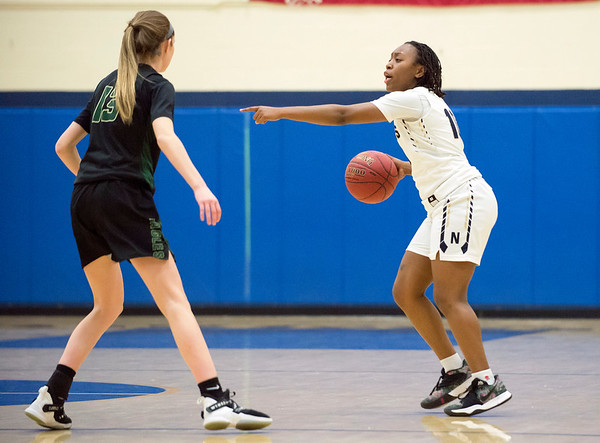 02/20/20 Wesley Bunnell | StaffrrNewington girls basketball defeated Enfield on thursday night at home in the first round of the conference tournament. Ashanti Frazier (10) directs her teammates on offense.