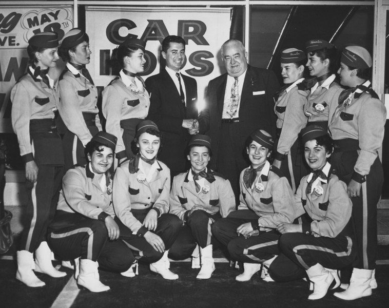Mayor Ed Biertuempfel poses with the wait staff of Adventure Car Hop on Route 22.