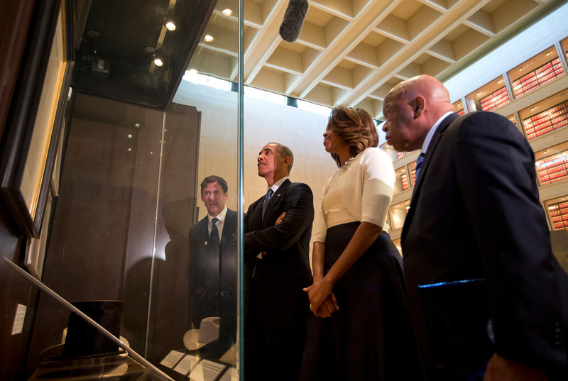 . From left, LBJ Presidential Library Director Mark Updegrove, President Barack Obama, first lady Michelle Obama and Rep. John Lewis, D-Ga., tour and exhibit in the Great Hall at the LBJ Presidential Library in Austin, Texas, Thursday, April 10, 2014, as they attend a Civil Rights Summit to commemorate the 50th anniversary of the signing of the Civil Rights Act. (AP Photo/Carolyn Kaster)