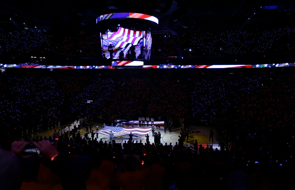 . The national anthem is performed before Game 1 of basketball\'s NBA Finals between the Golden State Warriors and the Cleveland Cavaliers in Oakland, Calif., Thursday, June 1, 2017. (AP Photo/Ben Margot)