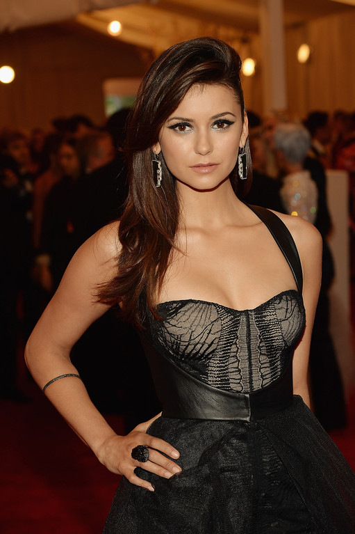 """. Nina Dobrev attends the Costume Institute Gala for the \""""PUNK: Chaos to Couture\"""" exhibition at the Metropolitan Museum of Art on May 6, 2013 in New York City.  (Photo by Dimitrios Kambouris/Getty Images)"""