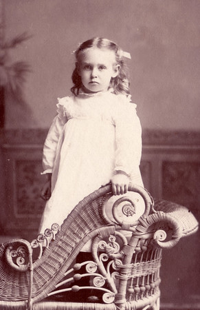 girl with rattan  chair