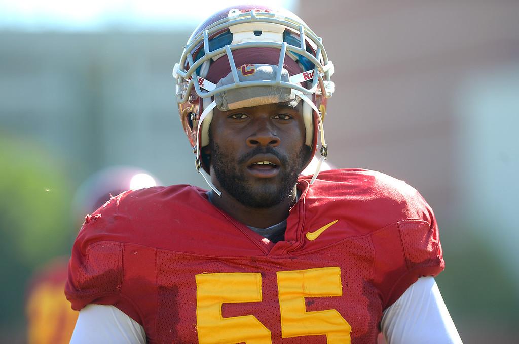 . Linebacker Lamar Dawson takes a break during USC football practice August 20, 2013.(Andy Holzman/Los Angeles Daily News)