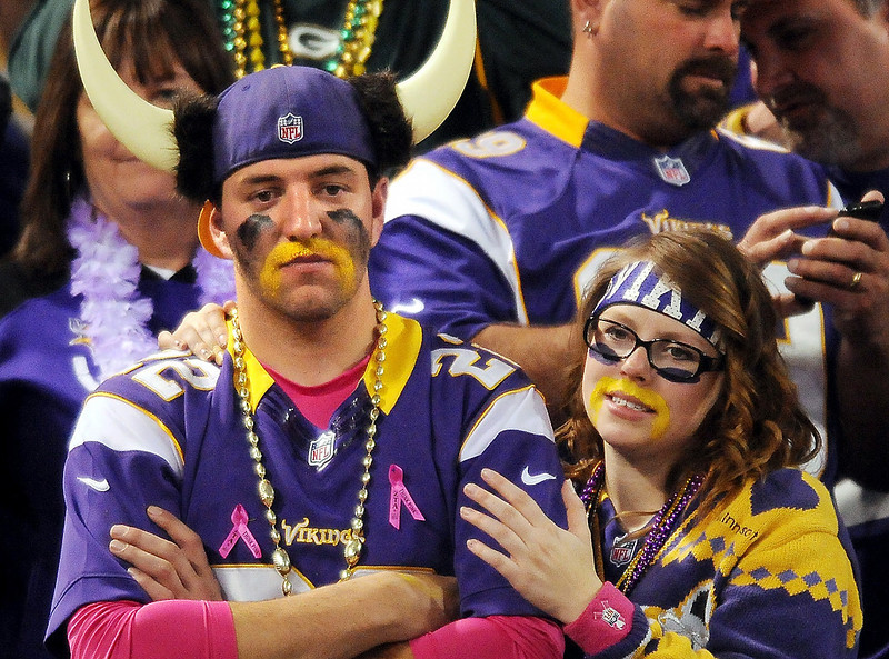 . Stacy Pontinen consoles a sad Joseeph Piskel, both from Bemidji, as they watch the Packers beat the Vikings in the fourth quarter. (Pioneer Press: John Autey)