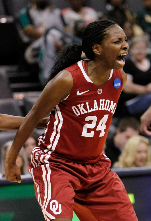 . Oklahoma\'s guard Sharane Campbell (24) celebrates after a basket against Tennessee during the regional semifinal in the women\'s NCAA college basketball tournament in Oklahoma City  Sunday  March 31, 2013.  (AP Photo/Alonzo Adams)