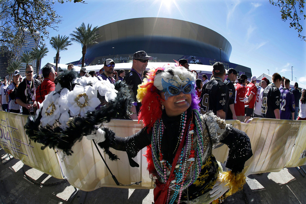 . Jennifer Jones dances outsidethe Superdome before the NFL Super Bowl XLVII football game between the San Francisco 49ers and the Baltimore Ravens on Sunday, Feb. 3, 2013, in New Orleans. (AP Photo/Gene Puskar)