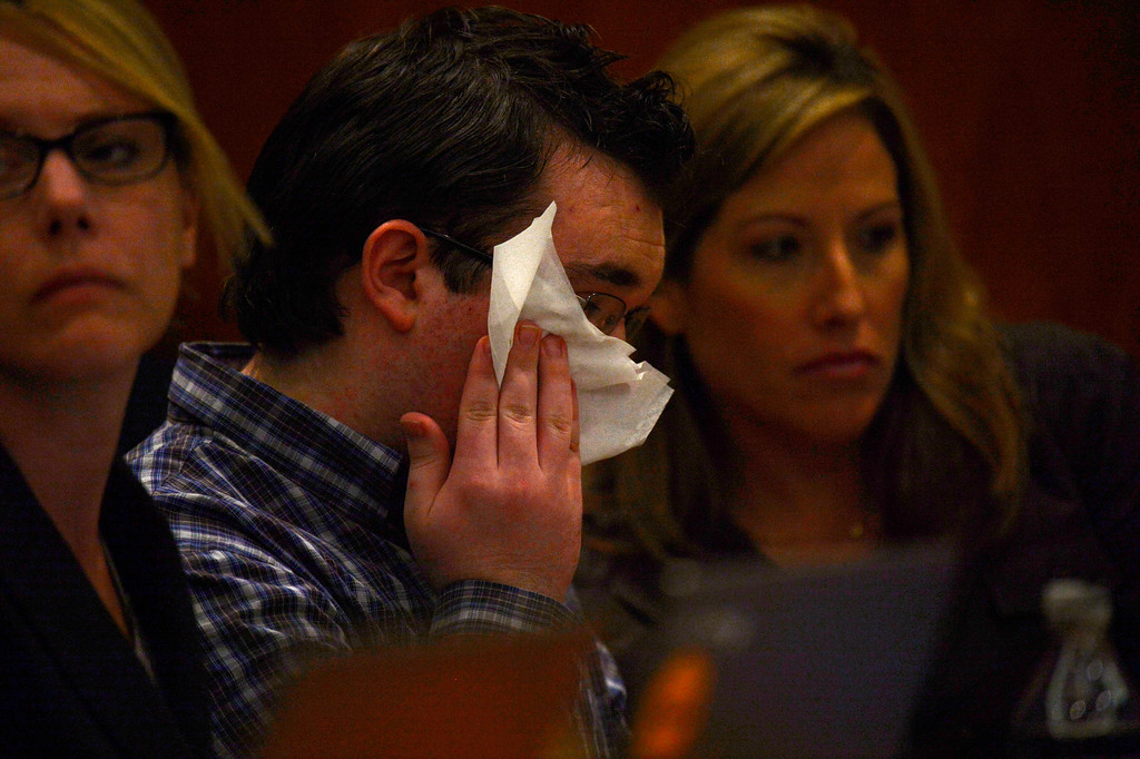 . Austin Sigg, between his attorneys, starts to cry during a video of photos of Jessica Ridgeway plays in Jefferson County Court, in Golden, for a sentencing hearing, November 18, 2013. Sigg, who pleaded guilty to the kidnapping and murder of 10-year-old Jessica Ridgeway, was in Courtroom 1-A with Chief Judge Stephen M. Munsinger presiding over the hearing. (Photo by RJ Sangosti/The Denver Post)