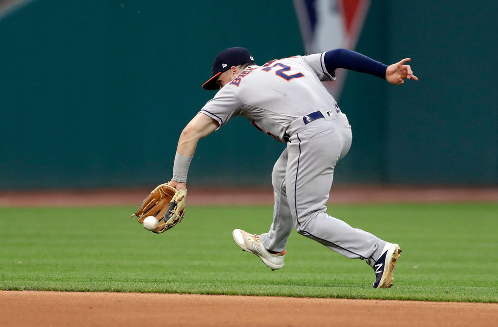 . Houston Astros\' Alex Bregman fields a ball hit by Cleveland Indians\' Greg Allen in the seventh inning of a baseball game, Thursday, May 24, 2018, in Cleveland. Allen was safe at first base. (AP Photo/Tony Dejak)