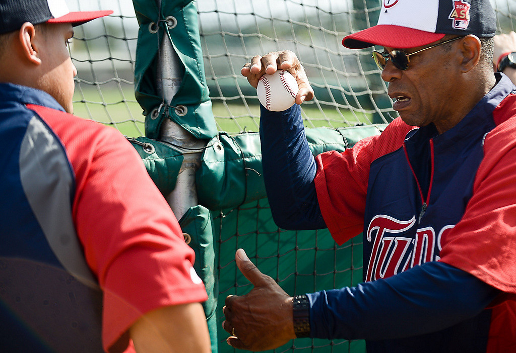 . Twins outfielder Oswaldo Arcia, left, gets some advice from former Twin and Hall of famer Rod Carew. (Pioneer Press: Ben Garvin)