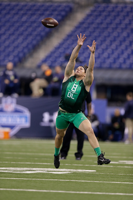 . Miami defensive lineman Anthony Chickillo runs a drill at the NFL football scouting combine in Indianapolis, Sunday, Feb. 22, 2015. (AP Photo/David J. Phillip)