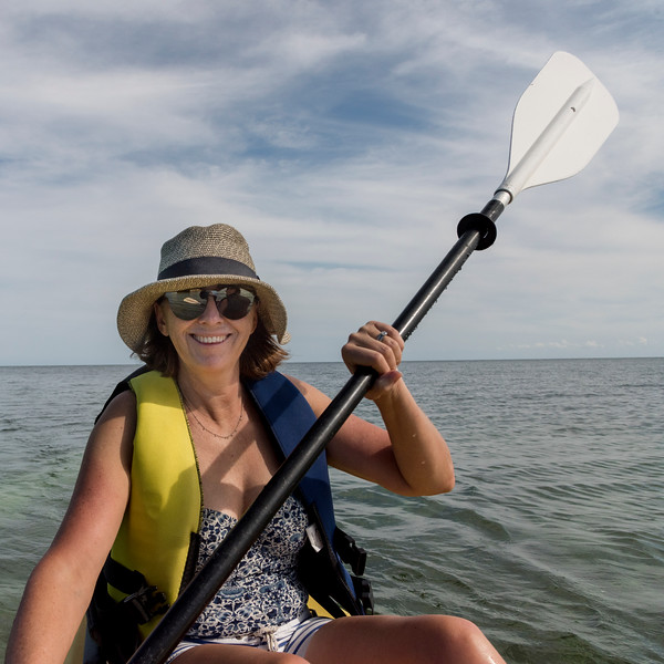 Woman kayaking in the sea, Turneffe Island, Belize