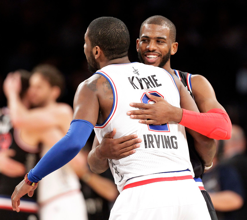 . West Team�s Chris Paul, right, of the Los Angeles Clippers, hugs East Team�s Kyrie Irving, of the Cleveland Cavaliers, after the NBA All-Star basketball game, Sunday, Feb. 15, 2015, in New York. The West Team won 163-158. (AP Photo/Kathy Willens)