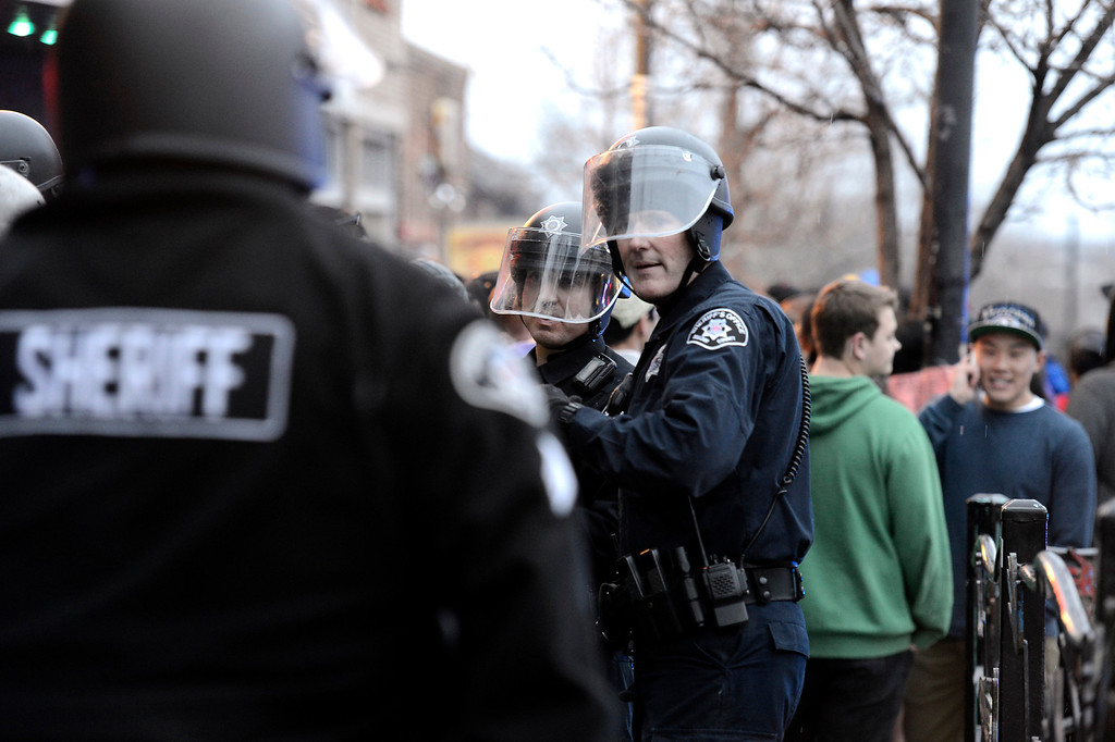 . Boulder County Sheriff\'s deputies dressed in riot gear try to keep the crowd under control during a disturbance at the The Fox Theater on Monday, March 11, in Boulder. Boulder Police responded with riot gear to keep the fans of the band Tyler the Creator under control.  Jeremy Papasso/Boulder Daily Camera