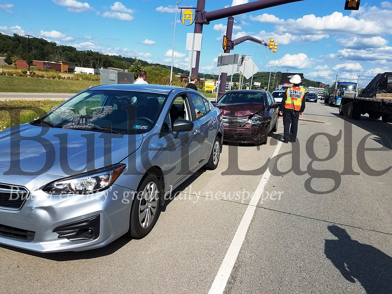 """""""Cranberry Township Volunteer Fire Company and Cranberry Township EMS responded to a crash that took place at about 4 p.m. Aug. 19 westbound on Route 228 near the I-79 north ramp."""" Photo by Samantha Beal."""