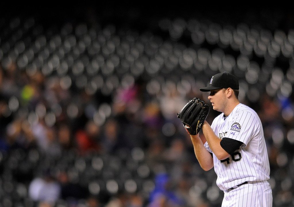 . Colorado Rockies starting pitcher Tyler Matzek prepares to throw in the seventh inning of a baseball game against the San Diego Padres on Friday, Sept. 5, 2014, in Denver. (AP Photo/Chris Schneider)