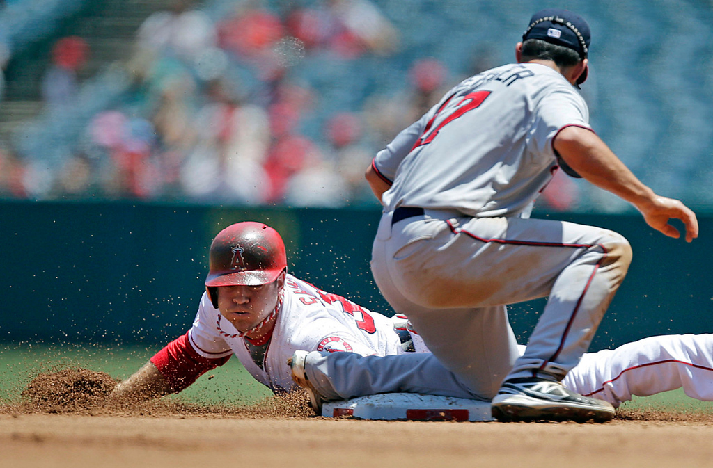 . Angels base runner J.B. Shuck, left, slides safely past Twins second baseman Doug Bernier for a stolen base during the first inning. Shuck later scored on an Albert Pujols single for the game\'s only run.   (AP Photo/Jae C. Hong)