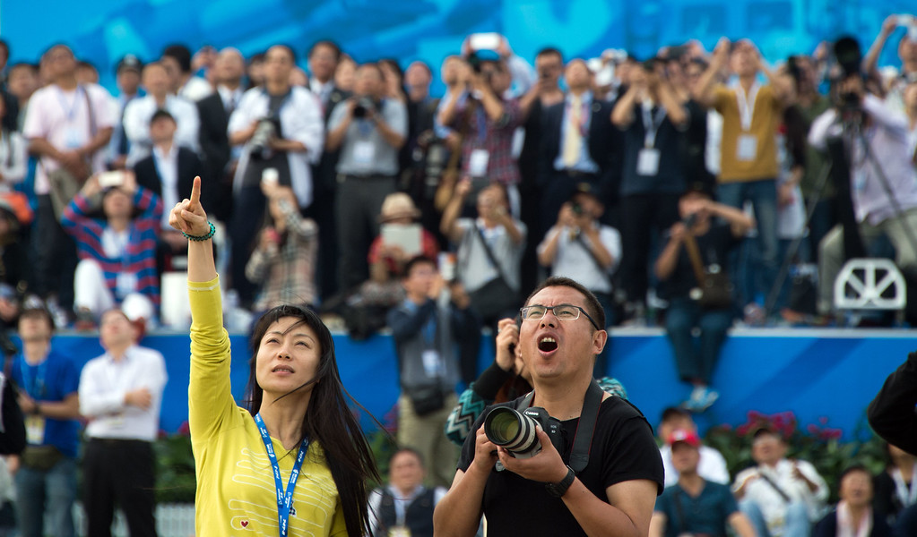. Spectators watch the Airshow China 2014 in Zhuhai, south China\'s Guangdong province on November 12, 2014. The 10th Airshow China 2014 takes place from November 11 to 16.   AFP PHOTO / JOHANNES  EISELE/AFP/Getty Images