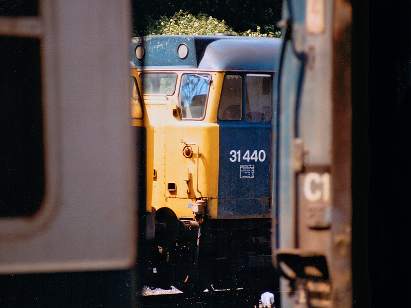 31440 tries to hide on the fuelling point at Ipswich on the 15th June 1986.  This loco was subsequently involved in a collision on the Hope Valley line at Chinley and withdrawn