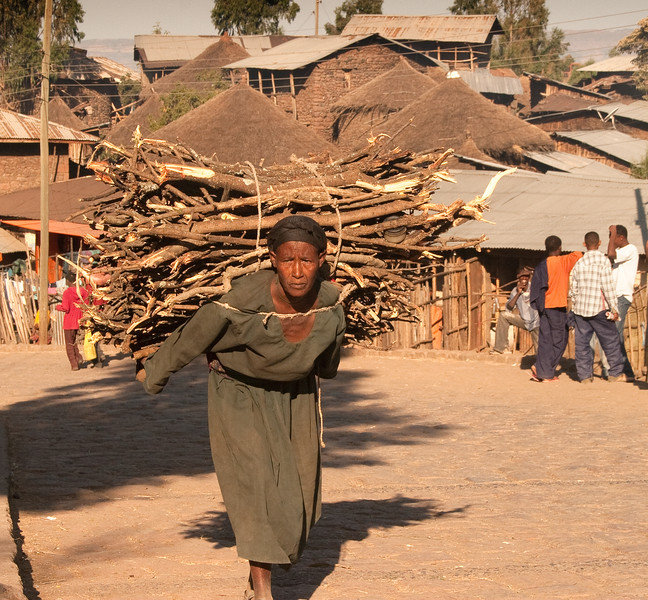 Marveling at the strength of a wood hauler in Lalibela, Ethiopia.