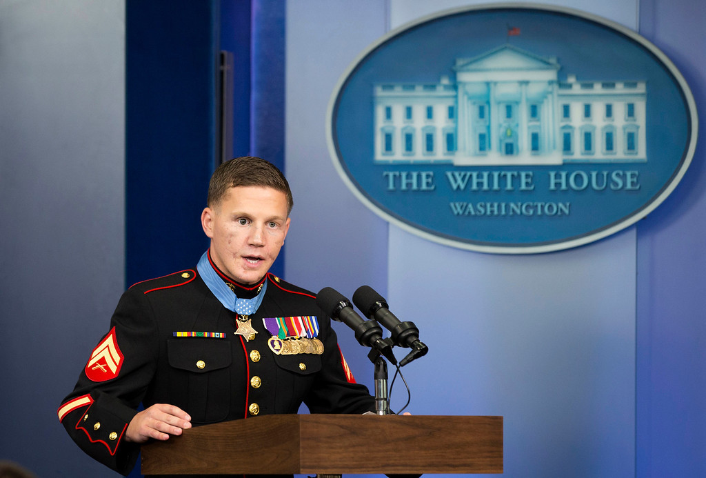 ". Retired Marine Cpl. William ""Kyle\"" Carpenter, 24, currently a student at the University of South Carolina, speaks in the Brady Press Briefing Room of the White House in Washington, Thursday, June 14, 2014, after being awarded the Medal of Honor by President Barack Obama.  (AP Photo/Jacquelyn Martin)"