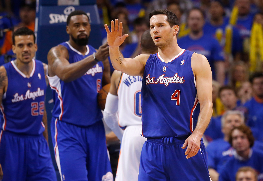 . Los Angeles Clippers guard J.J. Redick (4) gestures towards his bench in the third quarter of Game 1 of the Western Conference semifinal NBA basketball playoff series against the Oklahoma City Thunder in Oklahoma City, Monday, May 5, 2014. Los Angeles won 122-105. (AP Photo/Sue Ogrocki)