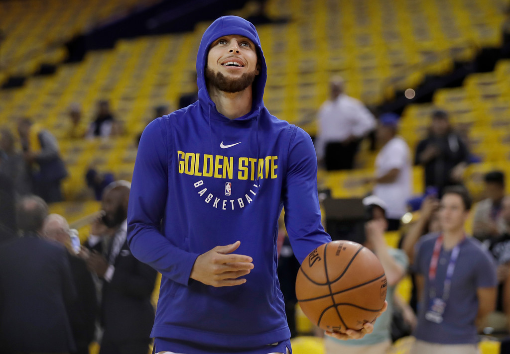 . Golden State Warriors guard Stephen Curry warms up before Game 1 of basketball\'s NBA Finals between the Warriors and the Cleveland Cavaliers in Oakland, Calif., Thursday, May 31, 2018. (AP Photo/Marcio Jose Sanchez)