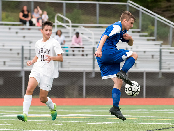 09/17/18 Wesley Bunnell | Staff Bristol Eastern soccer defeated New Britain 2-0 on Monday afternoon at Bristol Eastern High School. New Britain's Minel Mehmedovic (11) and Bristol Eastern's Patrick Brady (3).