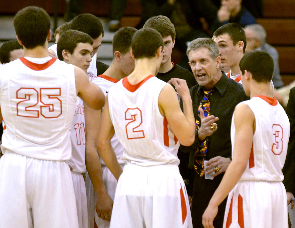 . Jeff Forman/JForman@News-Herald.com Mentor coach Bob Krizancic talks to his players during Mentor\'s 82-71 loss to VASJ Sunday in the Dunk4Diabetes Shootout at Walsh University in North Canton.