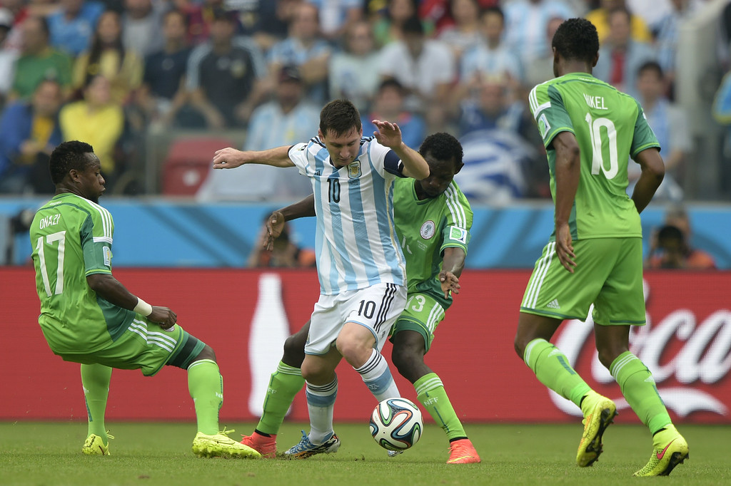 . Nigeria\'s midfielder Ogenyi Onazi (L), defender Juwon Oshaniwa (2nd R) and midfielder John Obi Mikel (R) vie for the ball with Argentina\'s forward Lionel Messi, during a Group F football match between Nigeria and Argentina at the Beira-Rio Stadium in Porto Alegre during the 2014 FIFA World Cup on June 25, 2014. JUAN MABROMATA/AFP/Getty Images