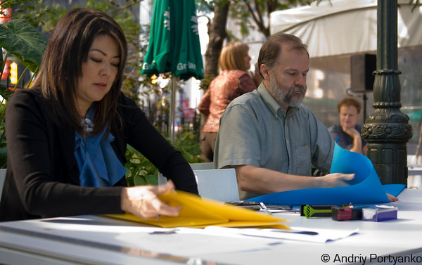 Linda Tomoko Mihara, Robert J. Lang creating origami in the Greeley Square Park during the Climate Week in NYC