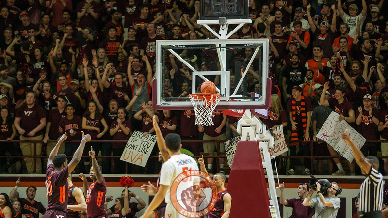 The Hokies signal for a jump ball after a UVa layup comes to a stop on the back of the rim at the end of the first overtime with the game still tied. (Mark Umansky/TheKeyPlay.com)