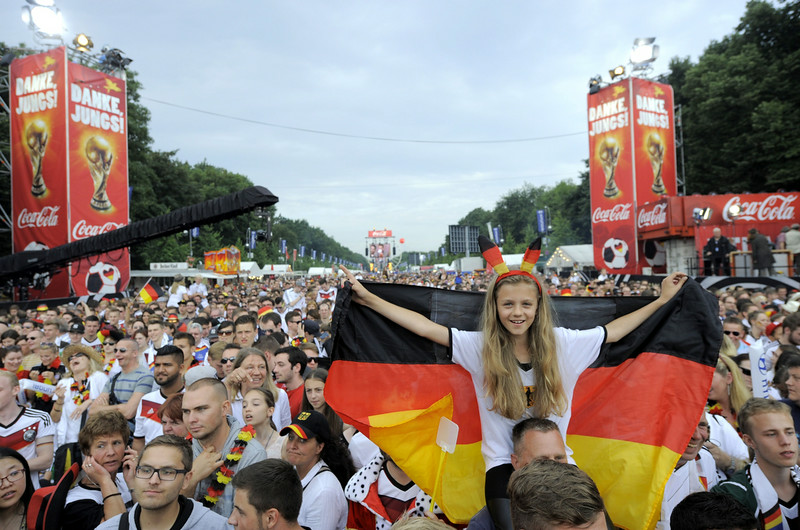 . German fans gather on the 17th of June street in Berlin on July 15, 2014, few hours before the victory parade of German national football team at landmark Brandenburg Gate to celebrate their FIFA World Cup title. Germany won their fourth World Cup title, after 1-0 win over Argentina on July 13, 2014 in Rio de Janeiro in the FIFA World Cup Brazil final game. (ROBERT MICHAEL/AFP/Getty Images)