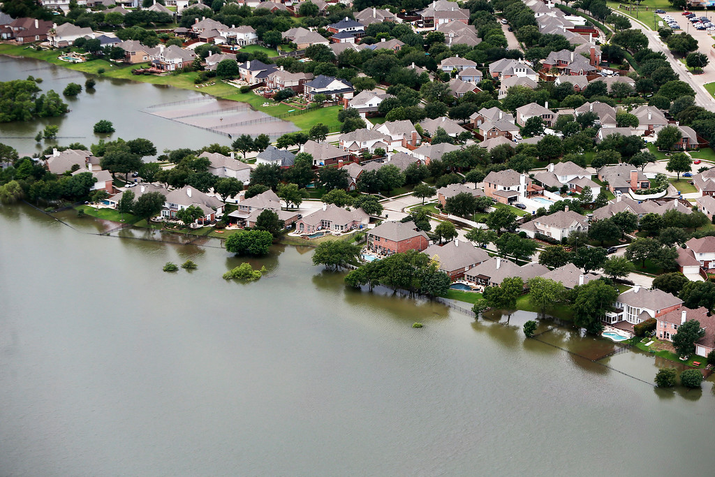 . Lake Lewisville encroaches on residents backyards, Friday, May 29, 2015 in The Colony, Texas. Floodwaters submerged Texas highways and threatened more homes Friday after another round of heavy rain added to the damage inflicted by storms. (AP Photo/Brandon Wade)