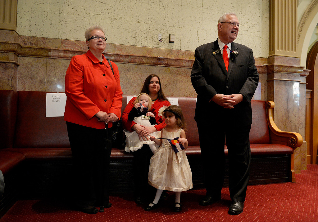 . DENVER, CO. - JANUARY 08: Senator Bernie Herpin stands with his wife, Linda, left, and daughter Tiffany Koch and her children, Caroline and Katie, during the first day of the new legislative session at the Colorado Capitol in Denver, CO January 08, 2014. Herpin won his seat in the John Morse recall election. (Photo By Craig F. Walker / The Denver Post)