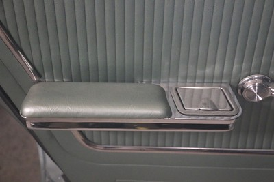 Rear driver's side arm rest