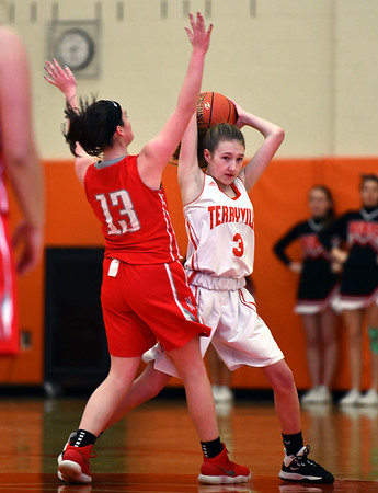 12/26/2019 Mike Orazzi | StaffrTerryville High School's Alice Benson (3) and Northwestern's Abigail Whalen (13) during Thursday's girls basketball game in Terryville.