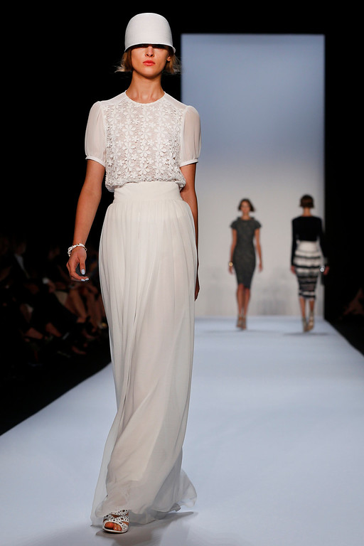 . The Badgley Mischka Spring 2014 collection is modeled during Fashion Week in New York, Tuesday, Sept. 10, 2013. (AP Photo/John Minchillo)