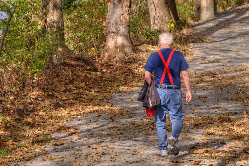 A man takes a walk along the leaf-covered trail along the Watauga River at Sycamore Shoals State Park in Elizabethton, TN on Friday, November 1, 2013. Copyright 2013 Jason Barnette