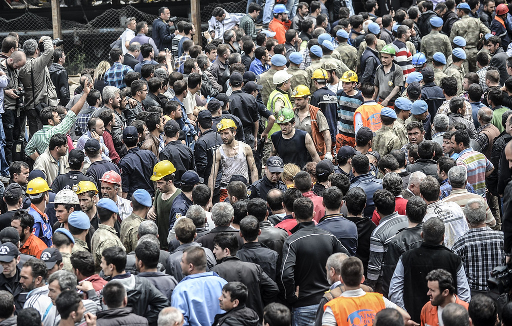. Miners leave after searching for hours hundreds of their colleagues who remain trapped underground on May 14, 2014 following an explosion and fire in their coal mine in the western Turkish province of Manisa killed at least 201 people. AFP PHOTO/BULENT KILIC/AFP/Getty Images