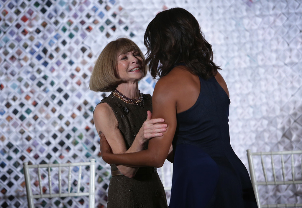 . U.S. first lady Michelle Obama (R) hugs Anna Wintour (L), Editor-in-Chief of Vogue magazine, after she was introduced by Wintour during a session of a Fashion Education Workshop, hosted by first lady Michelle Obama, in the East Room of the White House October 8, 2014 in Washington, DC.  (Photo by Alex Wong/Getty Images)