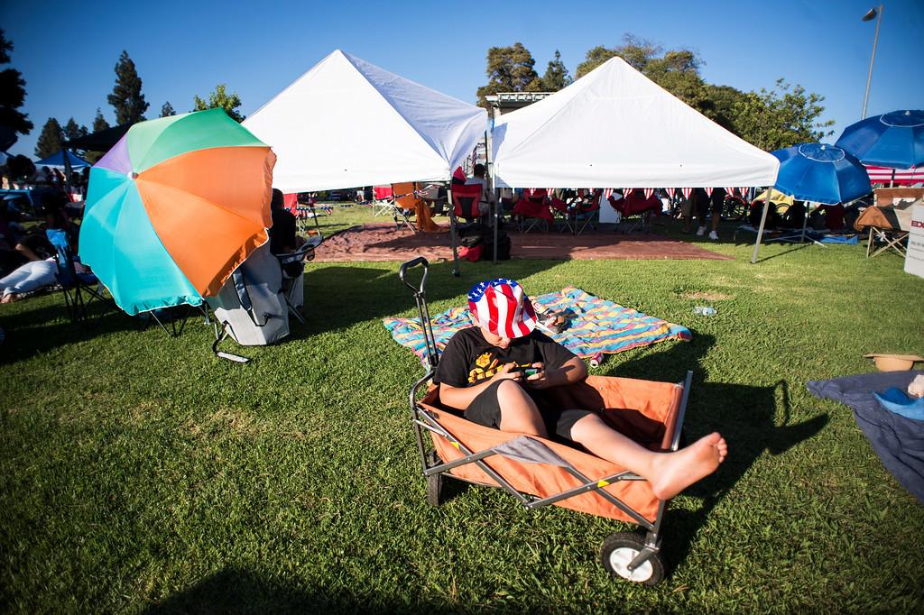 . Aidan O\'neill, 11, hangs out in a wagon  before La Mirada\'s annual fireworks show and festival Thursday night, July 3, 2014 at La Mirada Regional Park. (Photo by Sarah Reingewirtz/Pasadena Star-News)
