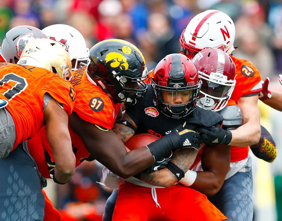 . South squad running back Donnel Pumphrey of San Diego State, center is tackled during the first half of the Senior Bowl NCAA college football game against North, Saturday, Jan. 28, 2017, at Ladd�Peebles Stadium, in Mobile, Ala. (AP Photo/Brynn Anderson)