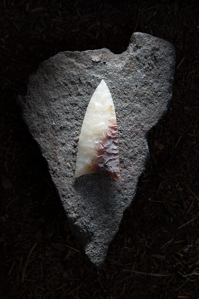 Portrait of a large and beautiful projectile point found at the Burnt Wickiup  Village.