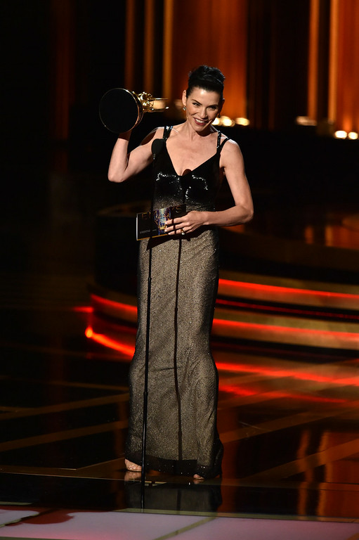 . Actress Julianna Margulies accepts Outstanding Lead Actress in a Drama Series for \'The Good Wife\' onstage at the 66th Annual Primetime Emmy Awards held at Nokia Theatre L.A. Live on August 25, 2014 in Los Angeles, California.  (Photo by Kevin Winter/Getty Images)