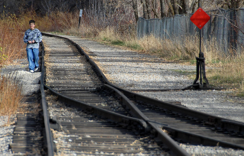 11/16/07 – It has been a beautiful fall. I couldn't pass this young boy walking along the railroad tracks. It just looked so peaceful.