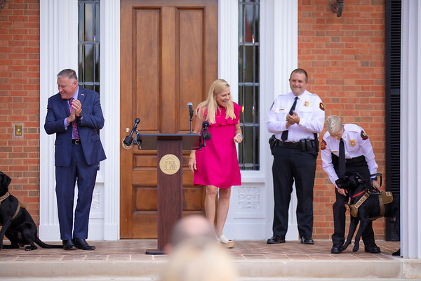 Dog Pinning Ceremony at the Governor's Mansion